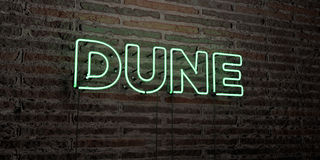 DUNE -Realistic Neon Sign on Brick Wall background - 3D rendered royalty free stock image Stock Images
