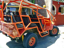 Dune sand buggy. Orange large Dune sand buggy royalty free stock photo