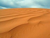 Dune Sky. Sand dune set against a turqoise sky Stock Photos