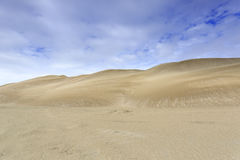 Dune under cloudy sky Royalty Free Stock Photos