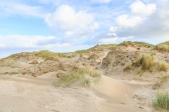 Dune landscape Dutch North Sea coast with slopes with dune grasses and bare valleys Stock Photo