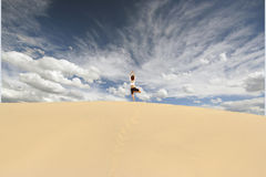 Dune Yoga. A woman in a yoga pose in death valley national park Royalty Free Stock Photo