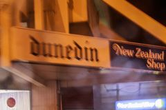 Dunedin, New Zealand - June 20, 2016: detail of shop in the streets of Dunedin city centre during night stock images