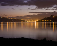 Dunedin, New Zealand at Sunset. Dunedin, New Zealand, shot at sunset from across the water Royalty Free Stock Photos