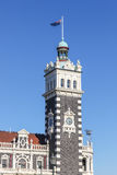 Dunedin Train Station Clocktower. The clocktower of Dunedin Train Station in the South Island of New Zealand. This trainstation was opened in 1906. The tower is Royalty Free Stock Photo