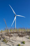 Dunepower. Wind power energy turbine behind a dune Stock Image