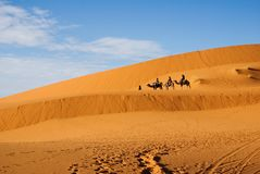 Duners of sahara and caravan Stock Photos