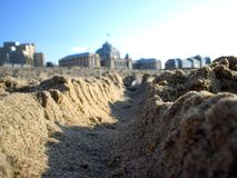 Dunes. A low shot from the beach viewing a couple of buildings Royalty Free Stock Photo