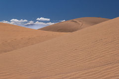 Dunes. Sand and a mountain on the back Stock Image