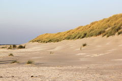 Dunes and beach at Ameland Island, Holland Royalty Free Stock Image