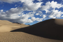 Dunes and Clouds, Great Sand Dunes Stock Photo