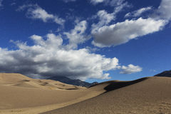 Dunes and Clouds, Great Sand Dunes. Blue Sky and Big Cloudsand Dunes at Great Sand Dunes National Park, Colorado Royalty Free Stock Photography