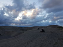 Dunes. Clouds sand motorcicle people royalty free stock images