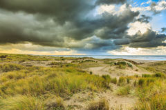 Dunes and dark clouds Stock Image