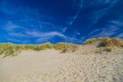 Dunes at De Haan, Belgian north sea coast against blue skyline Stock Photo