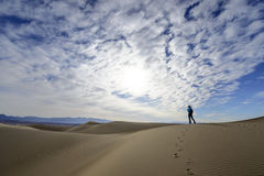 Dunes in Death Valley. A photographer walking in the dunes in Death Valley National Park Royalty Free Stock Image