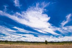 Dunes of the Dnieper with bizarre clouds royalty free stock photo