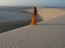 Dunes girl. Girl in dune at sunset Stock Images