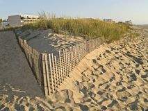 Dunes and Hotel. The beach and sand dunes in Ocean City Maryland Stock Photography