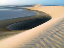 Dunes with lagoon. Lagoon with dune - National Park of the Lençois Maranhenses - Brazil Stock Photo
