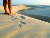 Dunes, lagoon and legs. Lagoon with dune - National Park of the Lençois Maranhenses - Brazil Royalty Free Stock Images