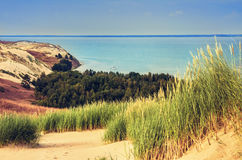 Dunes in Lithuania. Landscape of golden color dunes with green grasses, beautiful sky and the sea at Neringa, Naglis reserve near Pervalka in Lithuania royalty free stock photography