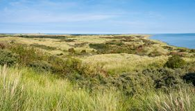 Dunes, North Sea and Waddensea coast of nature reserve Het Oerd on West Frisian island Ameland, Friesland, Netherlands. Panorama of dunes, North Sea and stock photos