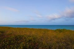 Dunes and ocean vibrant colors Stock Image
