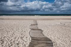 Dunes with pathway at the Danish North Sea coast Royalty Free Stock Photography