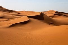 Dunes in the Sahara deformed by the wind, Morocco Royalty Free Stock Photo