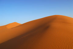 Dunes of Sahara Desert. Red Moroccan sands of Sahara Desert Stock Photo