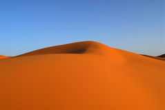 Dunes of Sahara Desert. Red Moroccan sands of Sahara Desert Stock Image