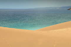 Dunes and sea. Sand desert dunes of Cyprus island - Turtle Beach - Dipkarpaz Royalty Free Stock Photo