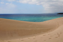 Dunes and sea. Sand desert dunes of Cyprus island - Turtle Beach - Dipkarpaz Royalty Free Stock Photography
