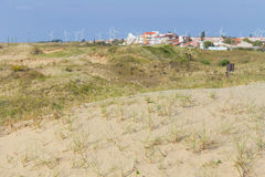Dunes, vegetation and buildings at Cassino beach Stock Images