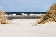 Dunes and waves Royalty Free Stock Image