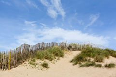 Dunes with Wooden Fence Royalty Free Stock Photography