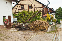 Dung heap with crane Stock Photo