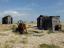 Dungeness beach with boats, Kent. Dungeness beach, kent, showing wrecked boats and buildings Royalty Free Stock Image