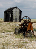 Dungeness beach with boats, Kent. Dungeness beach, kent, showing wrecked boats and buildings Stock Photography