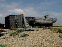Dungeness beach with boats, Kent. Dungeness beach, kent, showing wrecked boats and buildings Stock Image