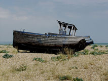 Dungeness beach with boats, Kent. Dungeness beach, kent, showing wrecked boats and buildings Royalty Free Stock Photography