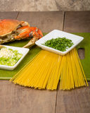 Dungeness crab and ingredients for pasta Royalty Free Stock Photography