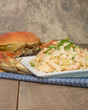 Dungeness crab pasta on white plate Royalty Free Stock Photo