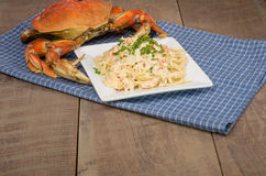 Dungeness crab pasta on white plate Royalty Free Stock Photography