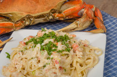 Dungeness crab pasta on white plate Stock Photos