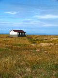 Dungeness. Headland, formed largely of a shingle beach in the form of a cuspate foreland. It shelters a large area of low-lying land, Romney Marsh Royalty Free Stock Photo