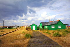Dungeness green huts landscape Kent England Royalty Free Stock Photography