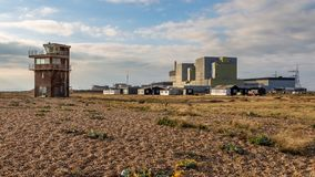 Dungeness Power Station, Kent, UK. Dungeness, Kent, England, UK - October 28, 2016: Dungeness Nuclear Power Station and the Old Lifeguard Station Stock Photos