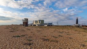 Dungeness Power Station & Old Lighthouse, Kent, UK. Dungeness, Kent, England, UK - October 28, 2016: Dungeness Nuclear Power Station, the Old Lifeguard Station Stock Photo